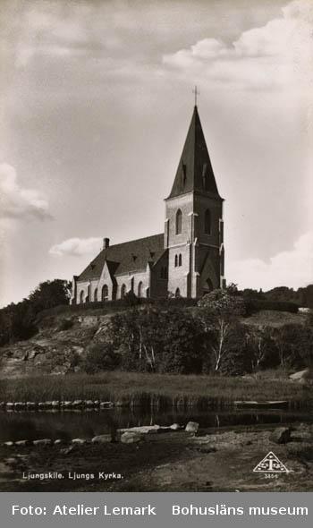 """Tryckt text på bildens framsida: """"Ljungskile. Ljungs kyrka.""""  T Foto."""