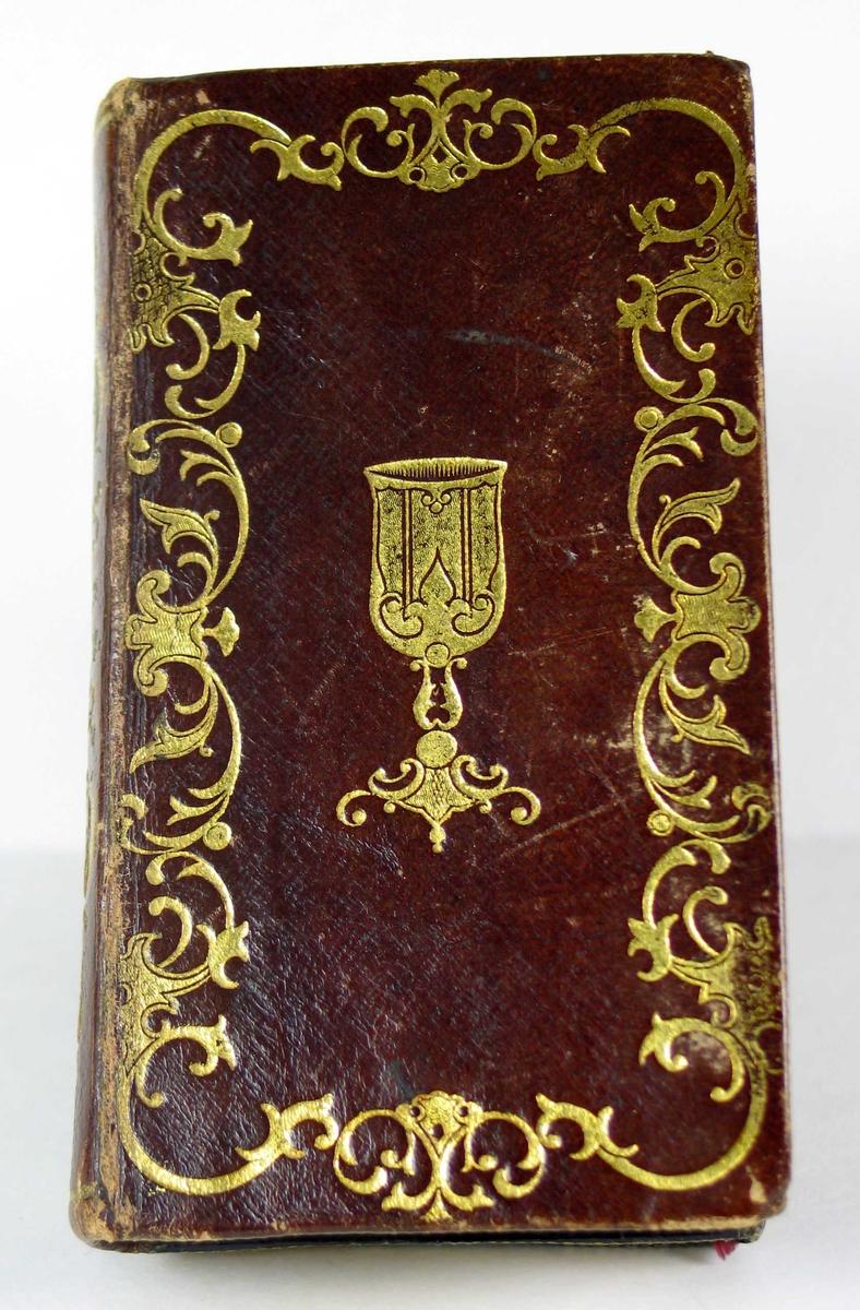 To bøker satt sammen: Salmebok og evangelier i brunt skinn med gullsnitt.
