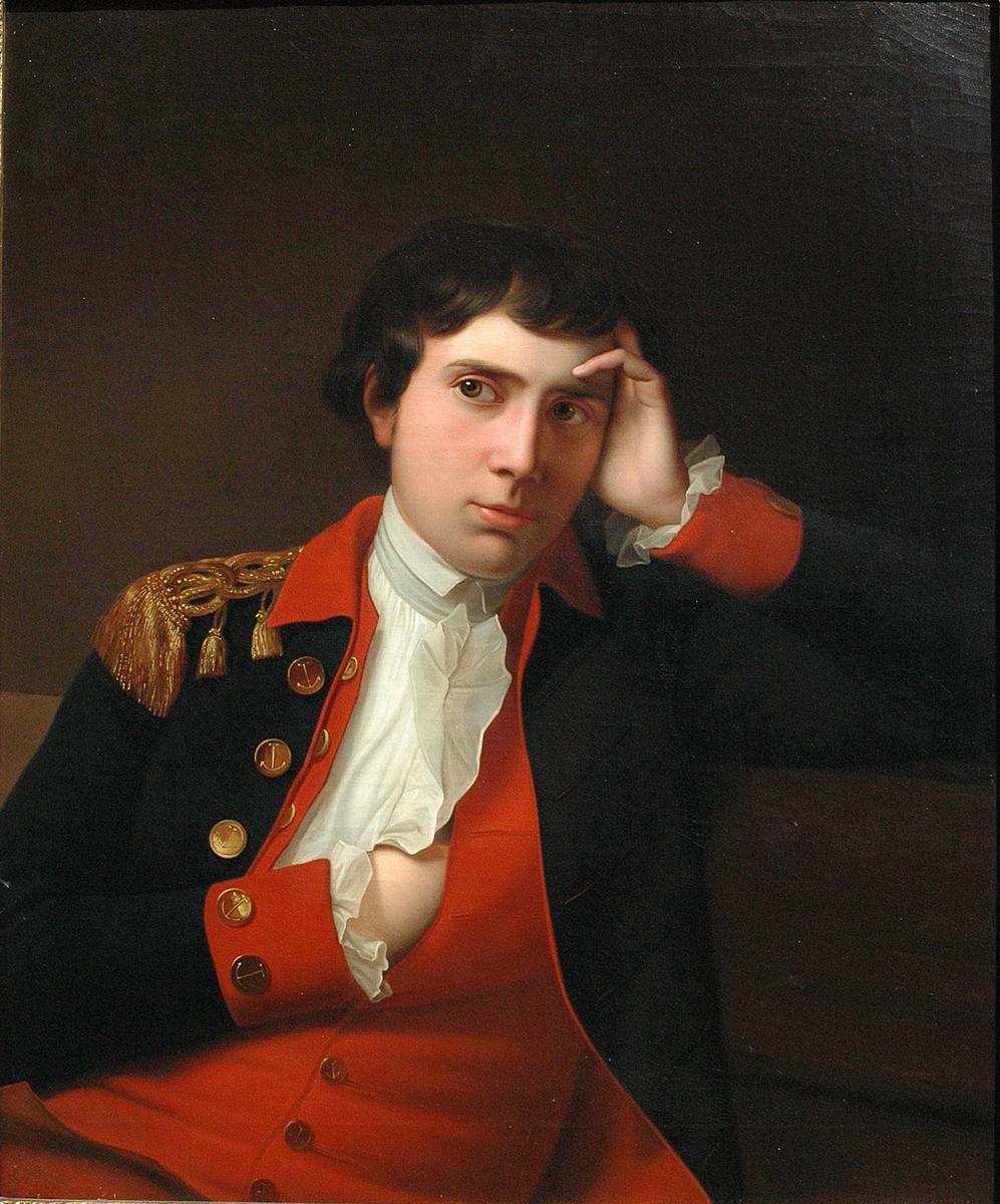 Mannsportrett. Mørkt hår, mørk uniformsjakke med rød vest, høgre hånd stukket inn i vesten foran, venstre hånd støttet mot hodet. Secondløytnant, senere admiral, H.C. Sneedorff. Far til Betzy Anker (g.m. Erik Anker)